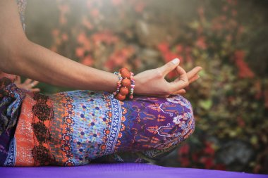 woman practice yoga meditation hands in mudra gesture closeup outdoor autumn day