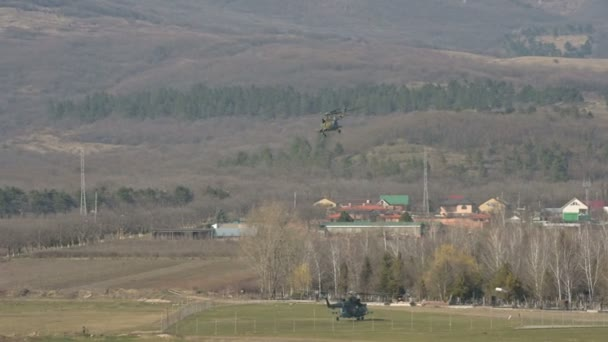 Military helicopter of the Russian Air Force takes off against the backdrop of the mountains of the North Caucasus