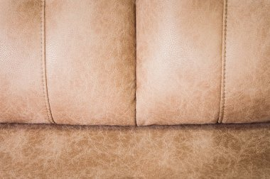 Close-up the Fragment of expensive beige leather sofa to indoors