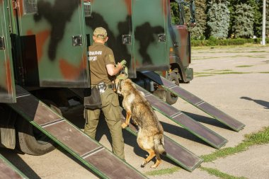 ODESSA, UKRAINE - August 1, 2018: Special police of police with trained police dogs. Mobile aviary for police dogs on military vehicle. Special forces of rapid reaction police, anti-terrorist forces