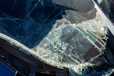 Terrible dangerous car after a fatal accident. Broken windshield. A broken car with broken glass. Car hazard. Reckless dangerous driving. Broken windshield after fatal accident with a pedestrian