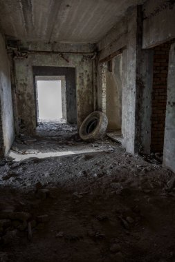 Interior of an abandoned administrative building. Interior ruins of an industrial factory. An old concrete staircase, ruins, corridor with garbage and mud, ruined walls of an unfinished office business center, Odessa