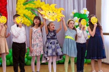 ODESSA, UKRAINE - March 8, 2017: Children at concert in primary school. Children's morning performance, concert, skit. Children's theatrical creativity, children's amateur performance in kindergarten congratulate mothers on Women's Day, Mother's Day