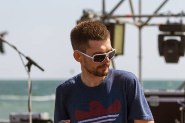 ODESSA, UKRAINE -August 24,2017: Big rock concert of popular Russian rapper, rock musician Noize MC on the stage of popular beach sports and music festival Z-Games. Rap Musician Noize MC. Select focu