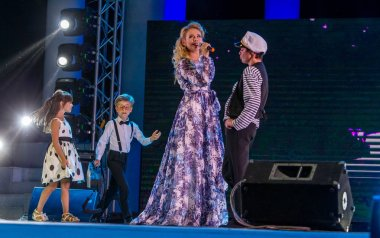 ODESSA, UKRAINE August 6,2018: a musical show. Alexandra Mamina and her dance folklore band from Odessa are played by Odessa criminal songs. hanson of sea hooligans on theatrical stage of the concert