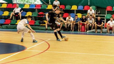 Odessa, Ukraine - July 28 2018: Unidentified players of local team playing in mini-football tournament on parquet floor