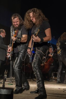 ODESSA, UKRAINE - January 24, 2019: Rock band playing live music on stage. Ivan Voron and the Beast are invited to Hard Rock Show. A tough musical event at a live hard rock music festival in Odessa