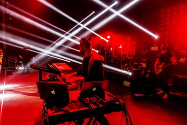 ODESSA, UKRAINE -Apr 12, 2019: Ukrainian singer ALEKSEEV on concert stage. Concert stage with lights and musical instruments during rock concert. Lights rays in dark on stage. Performance on stage