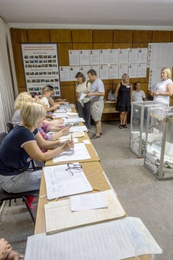 ODESSA, UKRAINE - July 21, 2019: elections in Ukraine. Place for people voting by voters in national political elections to parliament of Ukraine. Ballot box for voters. Electorate at polling station