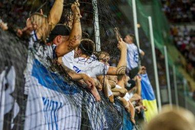 ODESSA UKRAINE - July 28, 2019: spectators at stadium. Crowds of fans in stands of football stadium during match Shakhtar (Donetsk) -Dynamo (Kiev). Grandstand with fans. Stands with football fans stock vector