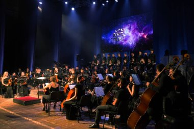 ODESSA, UKRAINE - July 16, 2019: Concert of the Andrei Cherny Symphony Orchestra on the theatrical stage of the Odessa Opera House. Musicians of the symphony orchestra perform OSCAR cinematic hits