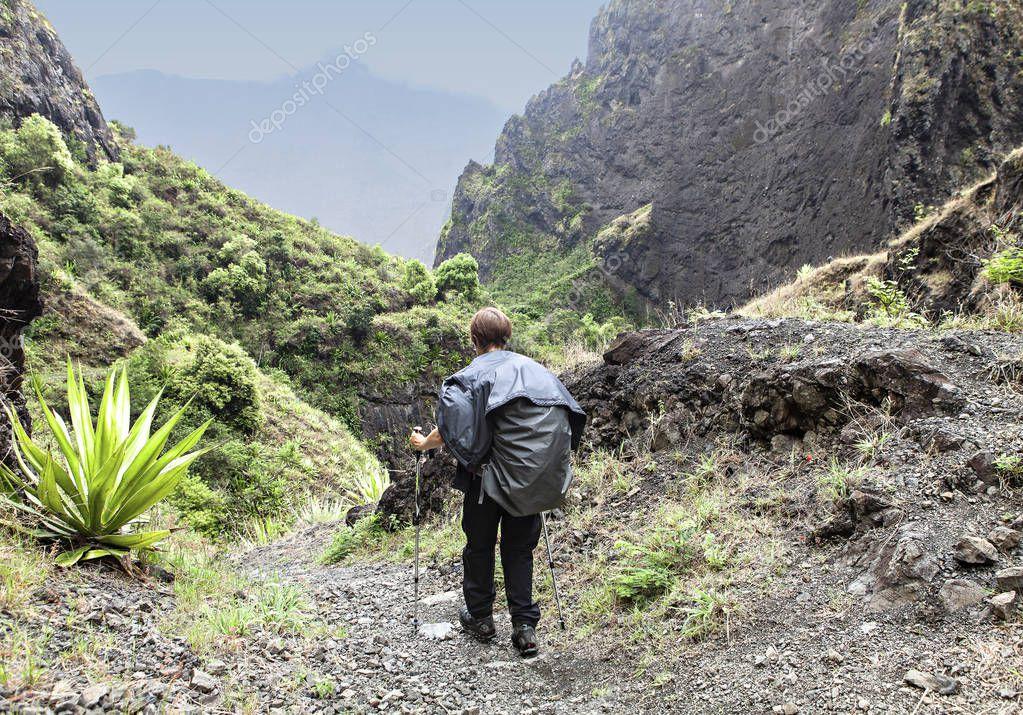 woman hiking on a muddy path