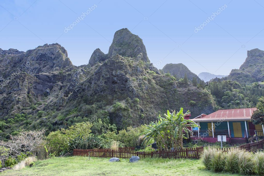 colorful refuge and mountains in the background