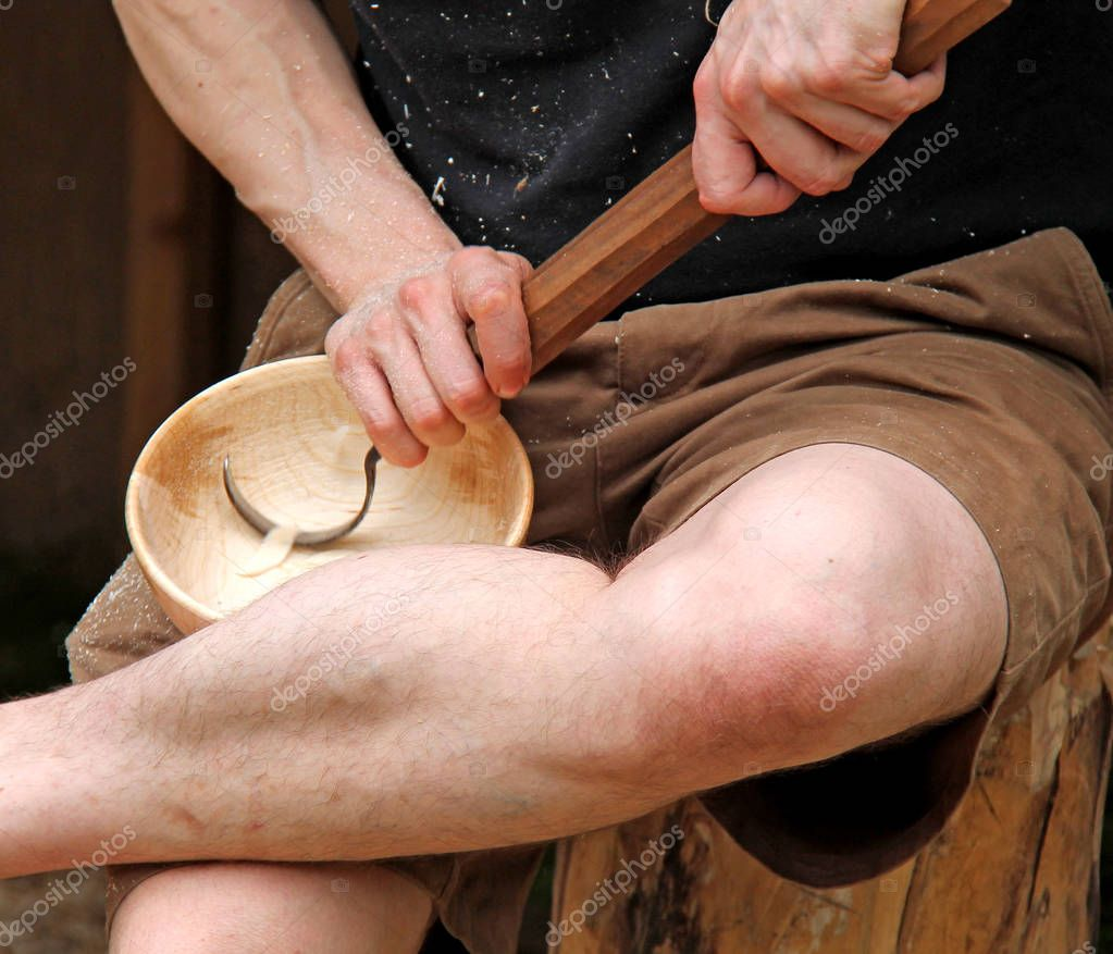 A Carpenter Carving Out the Inside of a Wooden Bowl.