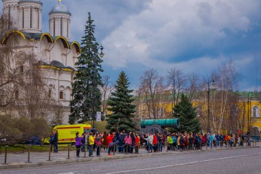 MOSCOW, RUSSIA- APRIL, 29, 2018: Crowd of people in front of old military ancient cannons. Collection incorporates foreign cannons of XVI-XIX centuries shown in the Moscow Kremlin
