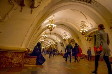 MOSCOW, RUSSIA- APRIL, 29, 2018: Unidentified people walking in Kievskaya Metro Station in Moscow. It is on the Koltsevaya Line, between Park Kultury and Krasnopresnenskaya stations