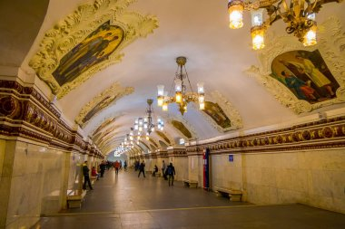 MOSCOW, RUSSIA- APRIL, 29, 2018: Beautiful indoor view of people in Kievskaya Metro Station in Moscow. It is on the Koltsevaya Line, between Park Kultury and Krasnopresnenskaya stations