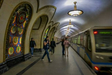 MOSCOW, RUSSIA- APRIL, 29, 2018: People in front of train in Novoslobodskaya subway station, the station is on the Koltsevaya Line of the Moscow Metro and opened in 1952 in Moscow, Russia