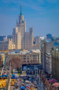 MOSCOW, RUSSIA- APRIL, 24, 2018: Above view of streets with traffic and above view of International Business Center in beautiful sunny day in the city of Moscow, urban skyline