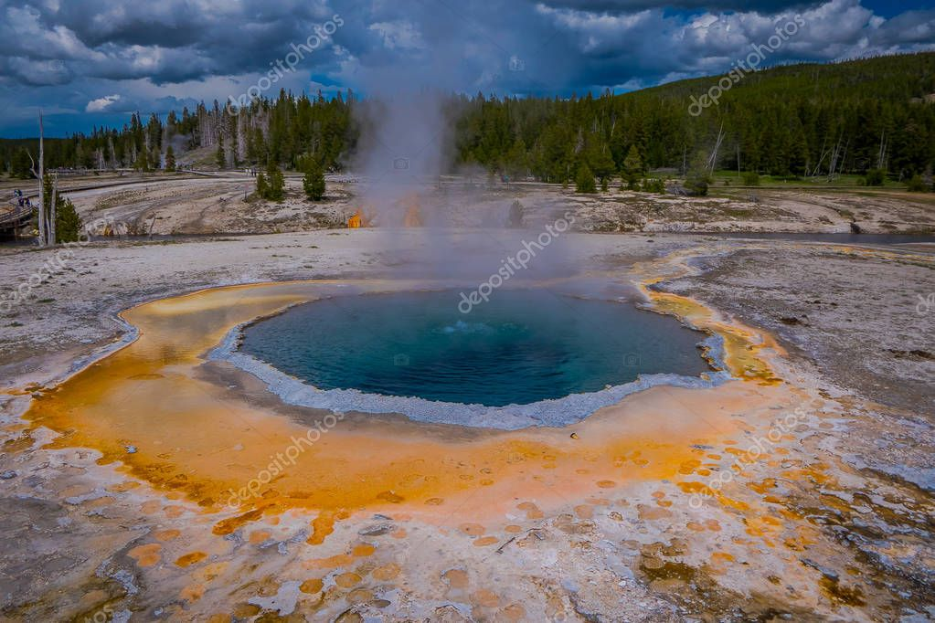 Crested pool hot spring and orange microbial mat in the old faithful geyser basin of Yellowstone National Park, Wyoming