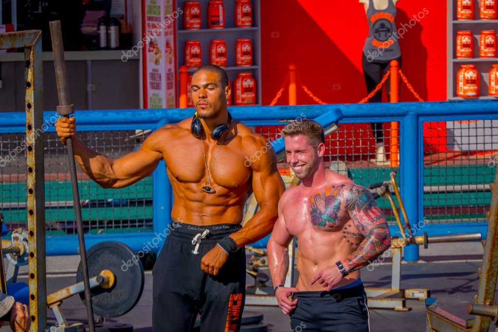 Los Angeles, California, USA, JUNE, 15, 2018: Outdoor view of unidentified body builder at Venice Beach Beach, is one of Californias most popular visitor attractions