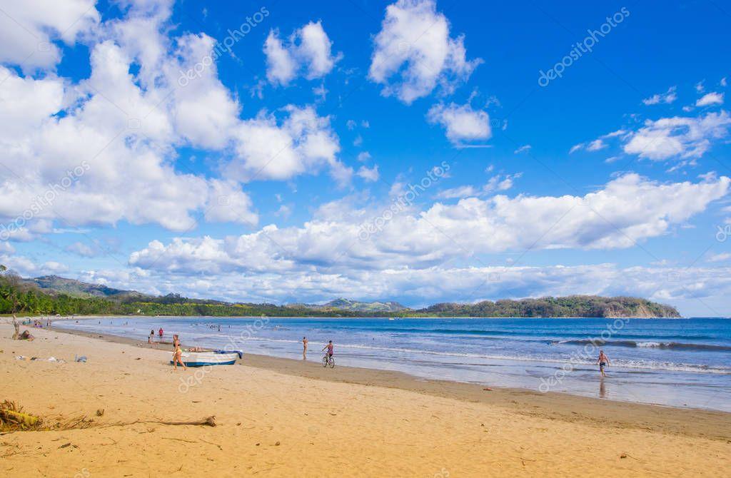 Samara, Costa Rica, June, 26, 2018: Outdoor view of unidentified people enjoying the beach of Samara Beach in Costa Rica.