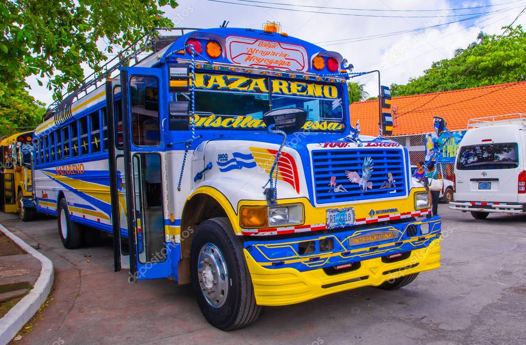 OMETEPE, NICARAGUA, MAY, 14, 2018: Outdoor view of old american school bus made over and reused in Central America. They are colorfully decorated and used for public or private transport