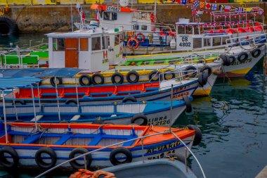 VALPARAISO, CHILE - SEPTEMBER, 15, 2018: Outdoor view of many boats and cranes docked in a harbor of Valparaiso