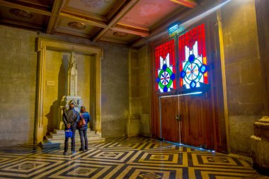 SANTIAGO, CHILE, OCTOBER 09, 2018: Tourists visiting inside of cathedral of Santiago de Compostela,The final destination for pilgrims walking along the world famous camino de Santiago