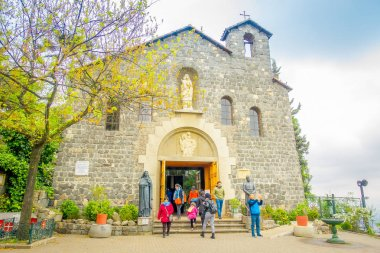 SANTIAGO, CHILE - OCTOBER 16, 2018: Unidentified people at the enter of la Maternidad de Maria at Cerro San Cristobal, Santiago de Chile, Sanctuary of the Immaculate Conception on San Cristobal Hill