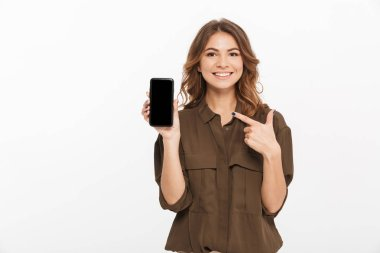 Portrait of a smiling young woman showing blank screen mobile phone isolated over white background stock vector