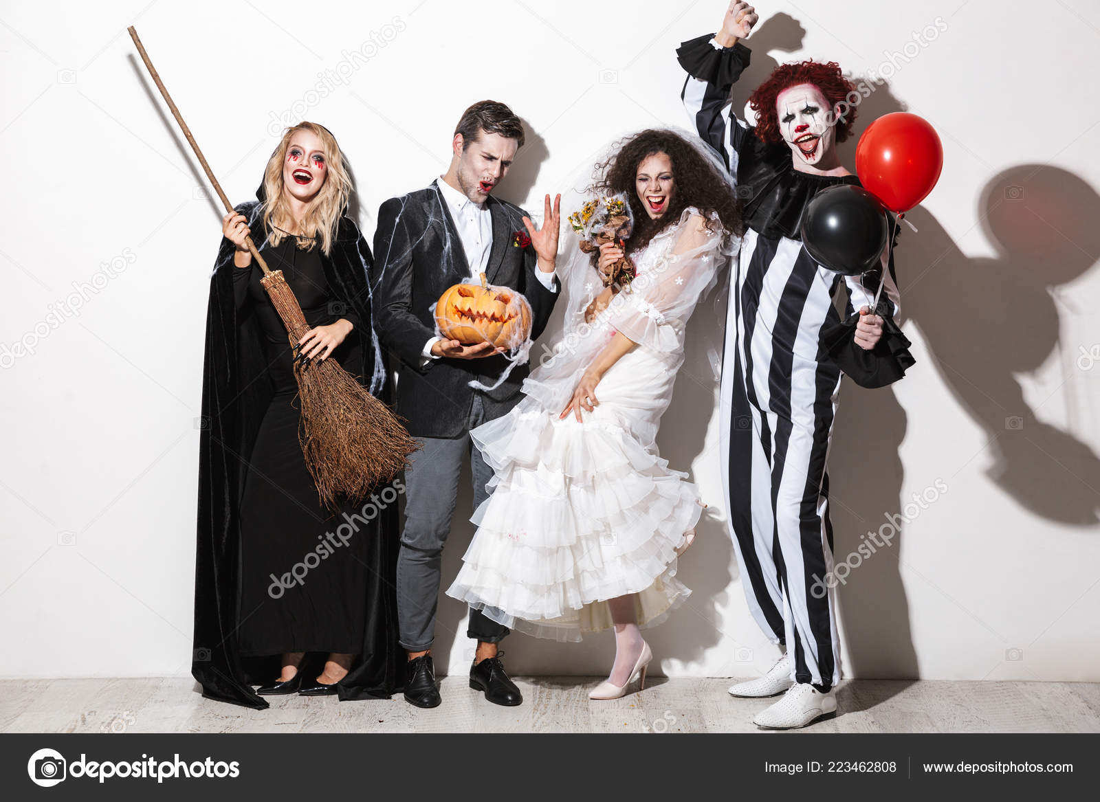 Halloween Group Costumes Scary.Group Cheerful Friends Dressed Scary Costumes Celebrating