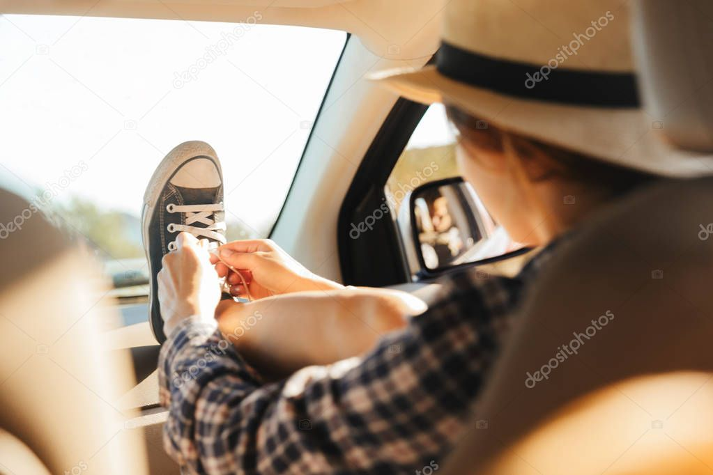 Image of beautiful woman 20s wearing straw hat using mobile phon