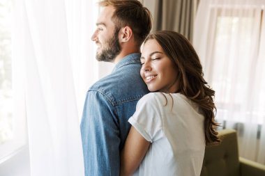 Beautiful young couple in love at home