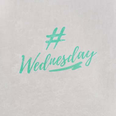 # Hashtag Wednesday written in orange on grey background as template in handwritten style
