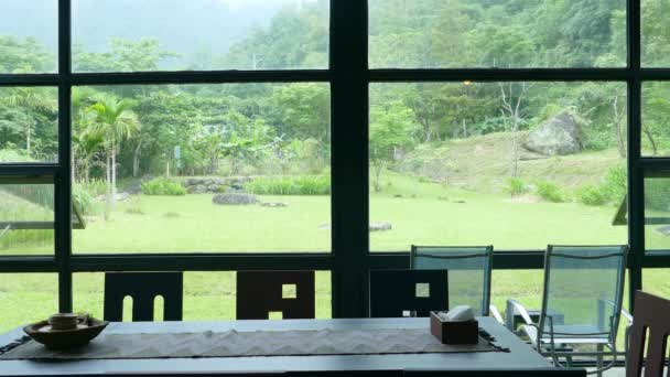 Cozy living room or restaurant interior design with nature scenic windows view