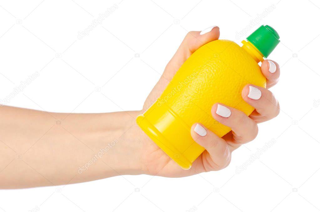 Yellow bottle with lemon juice in hand