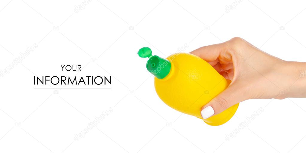 Yellow plastic bottle with lemon juice in hand fresh nature pattern