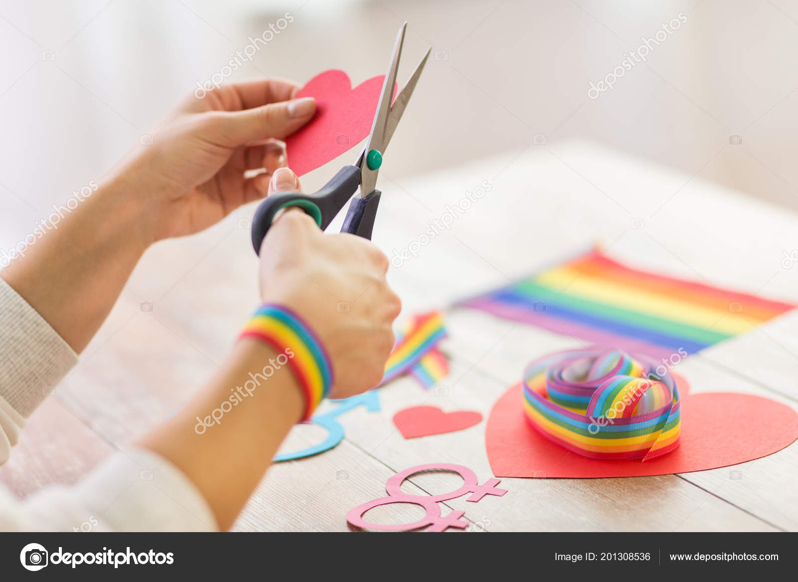 Hands Making Heart Decoration For Gay Party Stock Photo