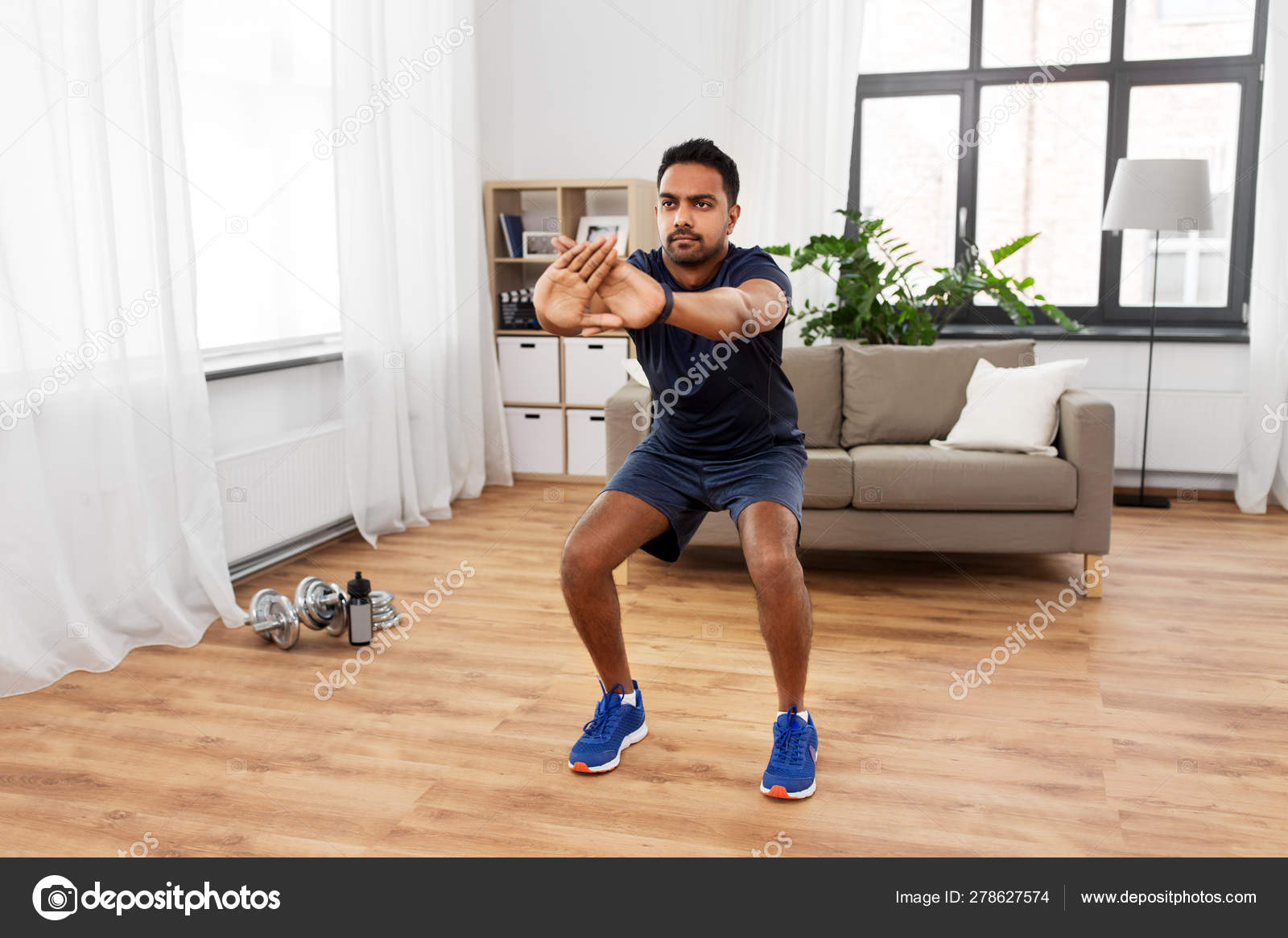 Indian man exercising and doing squats at home — Stock Photo