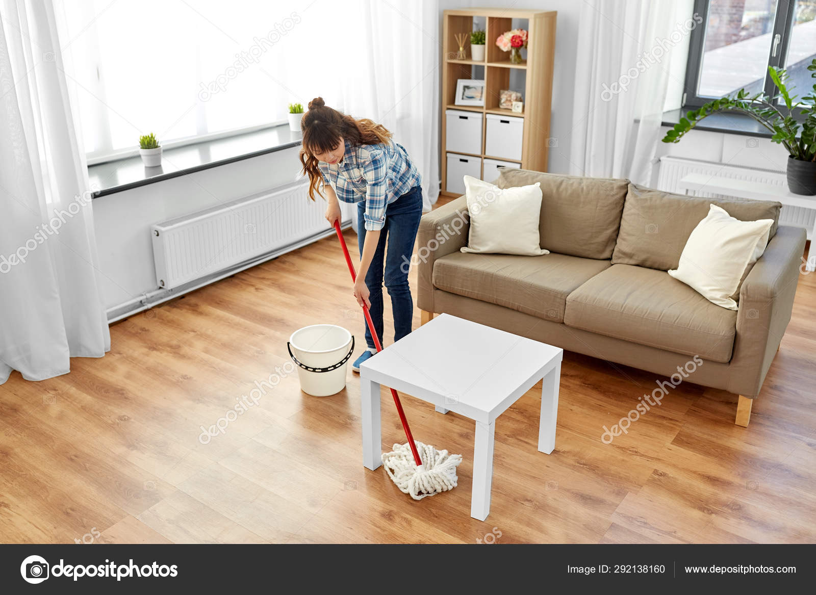 Woman or housewife with mop cleaning floor at home 10