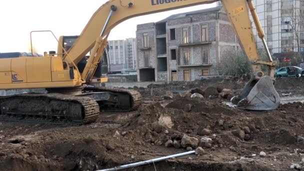 footage of builders working on construction site of modern building
