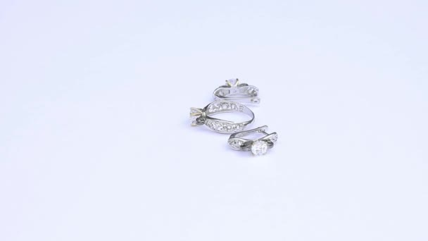 presentation of silver earrings and ring isolated on white background, close up