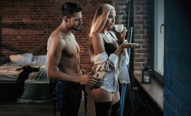Handsome, muscular guy seducing his sensual lover stock vector