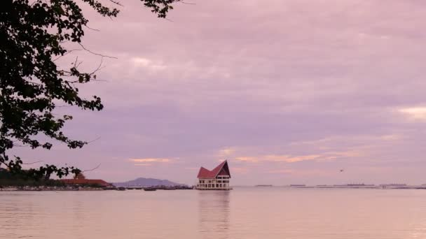 Time lapse of evening sky at sea with jetty at island background