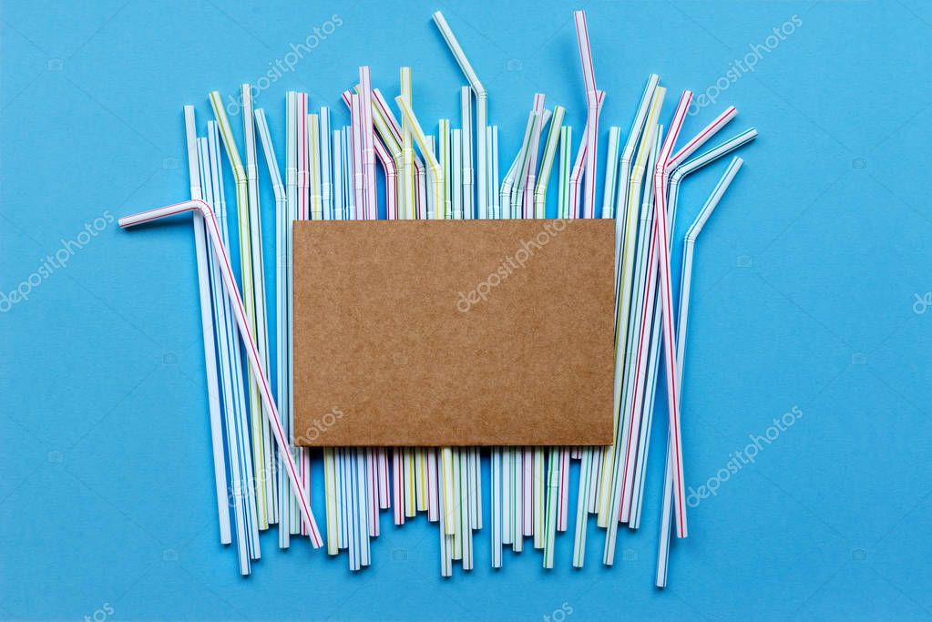 Colored drinking straw on a blue background