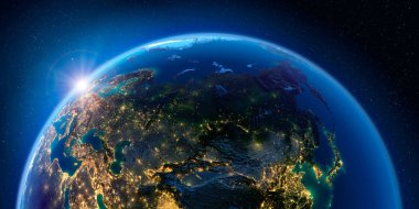Earth at night and the light of cities. Russia.