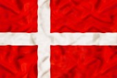 Fotografie Denmark country independent state national flag banner close-up with waving fabric texture