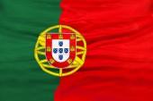 Portugália ország független állam nemzeti lobogója banner közelről a hullámzó szövet szerkezete