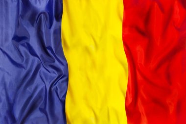 Romania country independent state national flag banner close-up with waving fabric texture